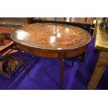 An Edwardian Sheraton revival style side table having typical inlay decoration throughout ,
