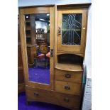 A hallway or similar arts and crafts / art nouveau dressing wardrobe having leaded light copper