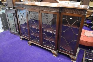 An early 20th century display cabinet having triple fronted beaded and glazed doors