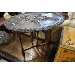 A 19th Century occasional table having naturalistic poker work and carved oval top on folding turned