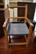 A small sized child's beech wood framed arm chair