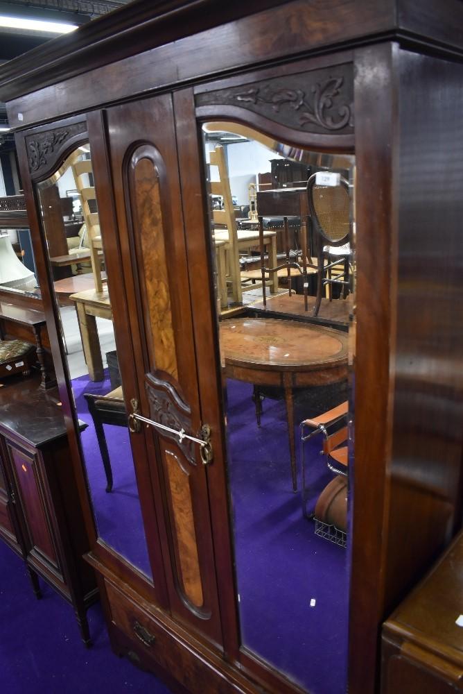 A Victorian mirror door wardrobe