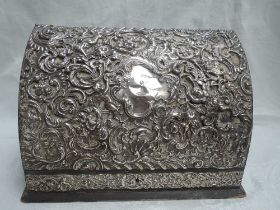 An Edwardian silver mounted desk top writing companion having hinged curved lid over a green