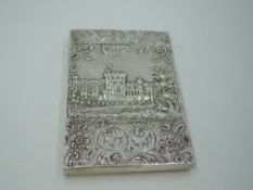 A Georgian silver castle top card case of rectangular form having a raised repousse scene of Windsor
