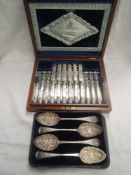 A canteen of twelve silver plated dessert knives and forks having mother of pearl handles and