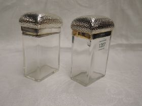 Two Victorian glass toiletry pots of tall rectangular form having plannished tops with monogrammed