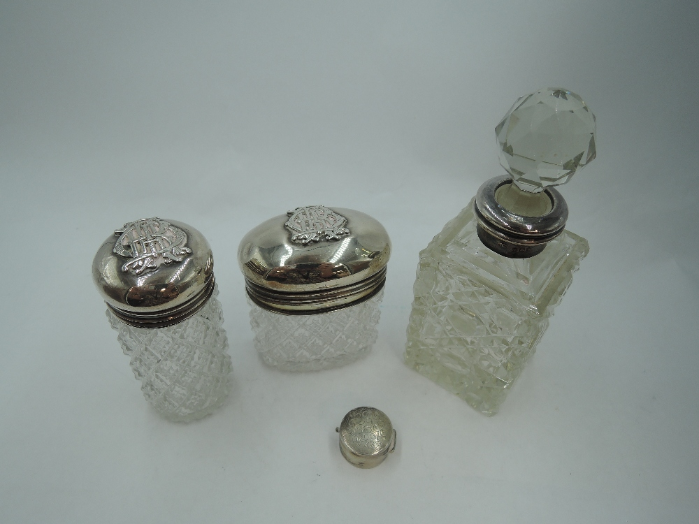 A cut glass dressing table pot having inner hinged silver gilt lid and hinged domed outer silver lid
