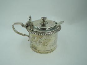 A Victorian silver mustard pot of plain cylindrical form having gadrooned rim and scallop shell