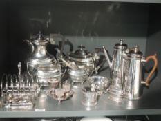 A selection of silver plate including four piece tea set, coffee pot, toast rack, mustard pot etc