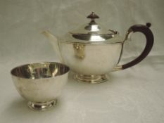 A silver tea pot and sugar bowl of plain form having fruit wood handle and knop, London 1937,