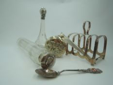 A selection of HM silver and white metal including three glass dressing table pots with silver/white