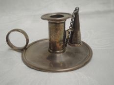 A Georgian silver chamber stick of small plain form having ring handle, detachable sconce and