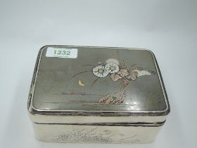 A Chinese silver box having black laquered wood lining, floral engravings to sides and yellow/rose