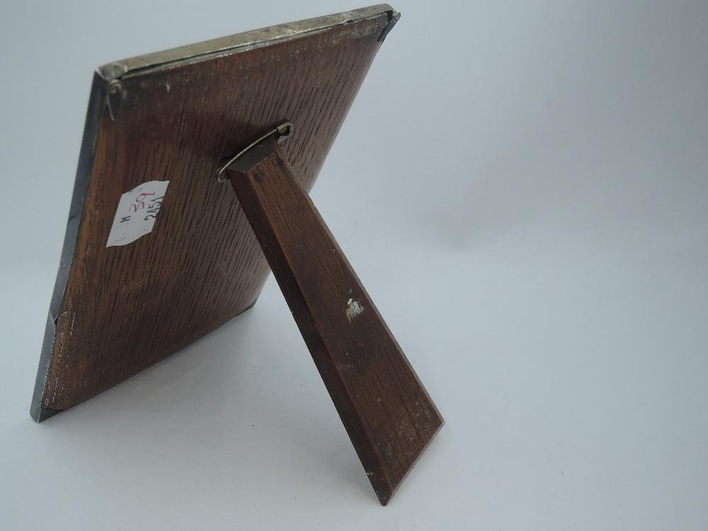 A silver photograph frame of plain rectangular form having wooden easel back, Birmingham 1925, - Image 2 of 2