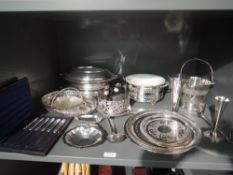 A selection of silver plate including lidded tureens, trays, cased butter knives, hip flasks, bottle