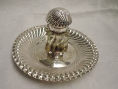 A Victorian silver inkstand having central moulded class inkwell with domed top on a gadrooned