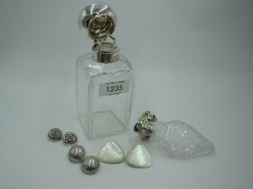 A Victorian glass bottle of rectangular form having glass stopper and silver hinged lid,