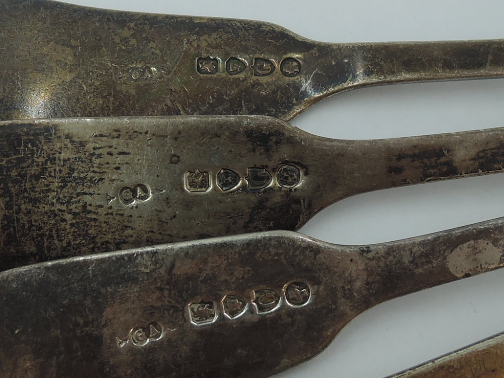 Four Victorian silver table spoons of fiddle back form having reeded decoration to rims and engraved - Image 2 of 3