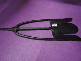 A vintage cast iron eel fishing spear