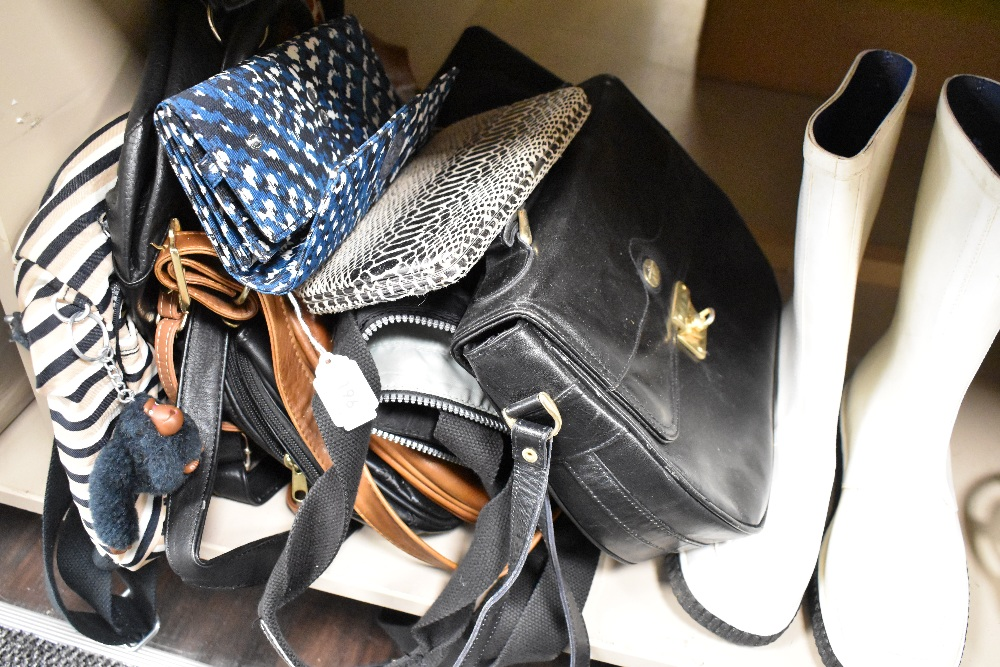 A selection of hand and clutch bags also a pair of wellies