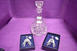 Two Caithness Christmas bells having etched designs with box and a glass wine decanter