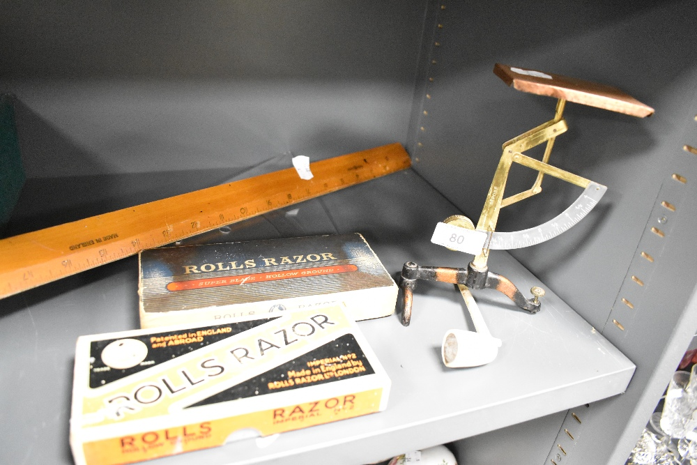 A selection of stationary including Depose letter balance and Rolls Razor sets