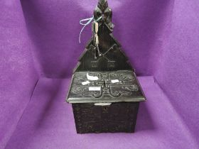 A gothic styled church collection box having a Black Forest style design with wrought iron