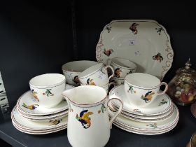 An art deco designed part tea service by S . Hancock & Sons in the Cockatoo pattern