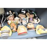 A selection of chalk ware plaques and character mugs including Royal Doulton and Legend Products