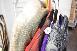 A selection of vintage and retro ladies clothing including heavily beaded tops, checked jacket,