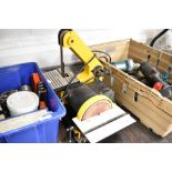 A Perform bench mounted belt and disc sander
