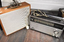 A Coumber Worcester F10 speaker cabinet and a Grundig Yacht boy radio set