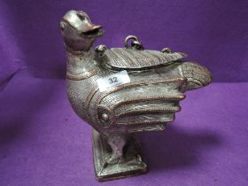 An Indian made cast metal storage container or tobacco jar in the form of a bird
