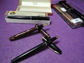 A selection of stationary ink and ball point pens including Burnham Shaeffers and Parker