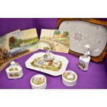 An antique porcelain dressing table set in fine condition hand decorated with cottage scenes with
