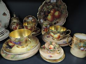 A selection of tea and coffee wares by Royal Worcester being hand decorated by various artists