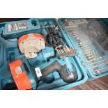 A battery powered Makita drill with accessories
