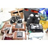 A selection of binoculars and photographic cameras including Swallow 8x40 and Agfa Isolette