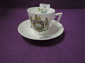 A tea cup and saucer by Foley China decorated with supporters of the colonies