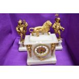 An impressive marble and ormolu mantle clock and garniture set having conquistador figures and