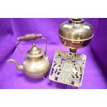 An antique brass cast fire trivet or kettle stand having French coat of arms also kettle and lamp