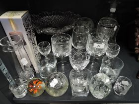A selection of clear cut crystal glass wares including etched glasses and Scottish paper weight