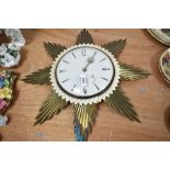 A mid century starburst styled wall clock by Metamec