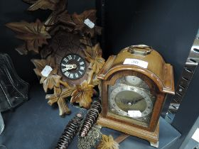 Two clocks including wall mounted German style cuckoo clock and Tempus Fugit mantle clock