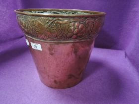 A Art Nouveau copper planter having grape and leaf rim design stamped for Keswick school of