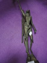 A bronze art deco geometric styled figure of an angel holding chalice atop a rocky outcrop 42cm