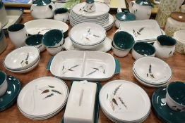 A selection of tea and dinner wares by Denby in the Greenwheat design