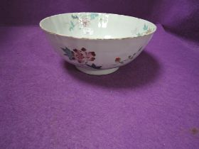 An antique Chinese porcelain punch or slop bowl having hand decorated naturalistic design