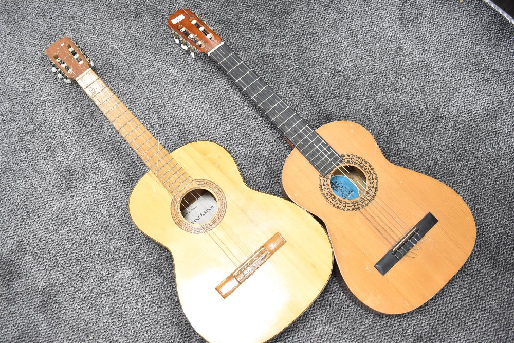 Two vintage Spanish guitars, small sizes, labelled BM Clasico and Hermanos Rodriguez