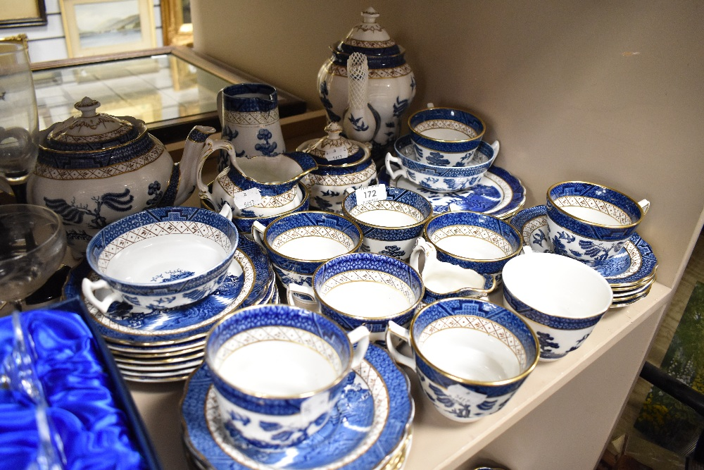 A selection of tea wares, cups and saucers by Doulton and Booths in the Real Old Willow design